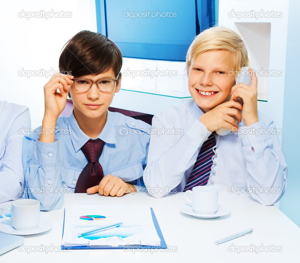 Two smart kids in the office