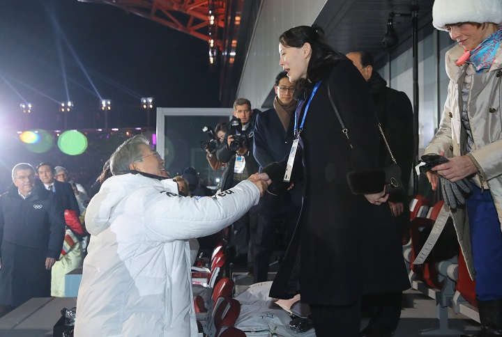 South Korean President Moon Jae-in shakes hands with Kim Jong Un's younger sister Kim Yo Jong at the Winter Olympics opening ceremony in Pyeongchang